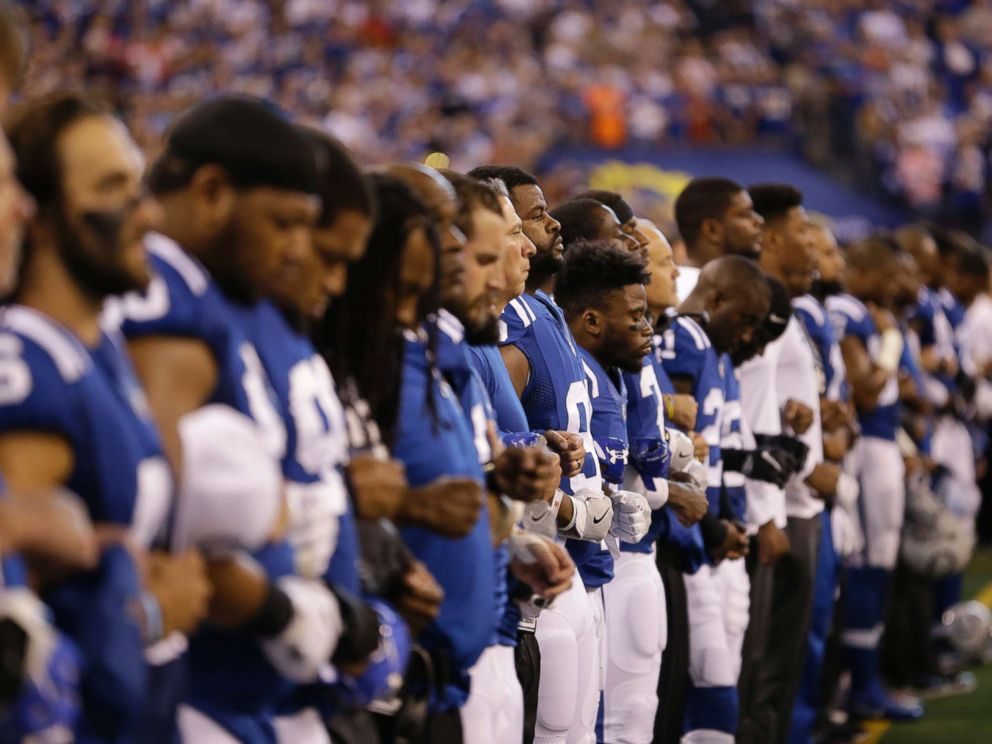 PHOTO: Members of the Indianapolis Colts lock arms during the playing of the national anthem before an NFL football game against the San Francisco 49ers, Oct. 8, 2017, in Indianapolis.