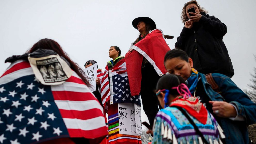 Activists listen to speakers during the Indigenous People's March on the National Mall at the Lincoln Memorial, Jan. 18, 2019.