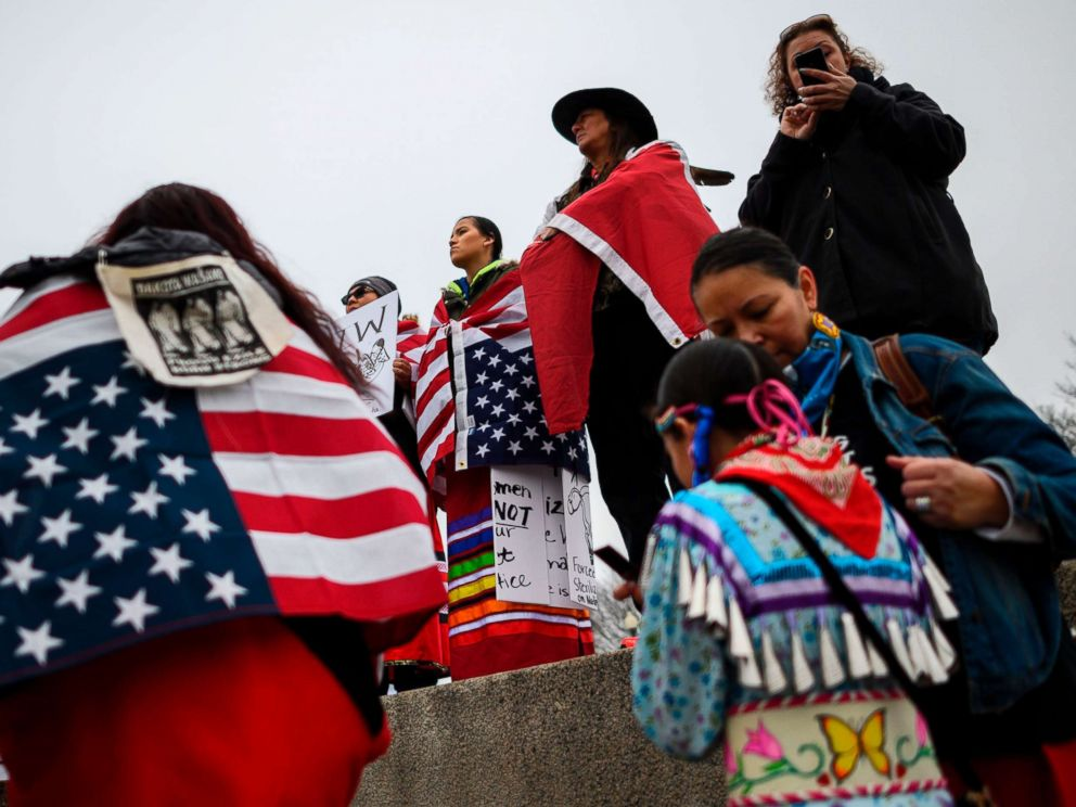 PHOTO: Activists listen to speakers during the Indigenous Peoples March on the National Mall at the Lincoln Memorial, Jan. 18, 2019.