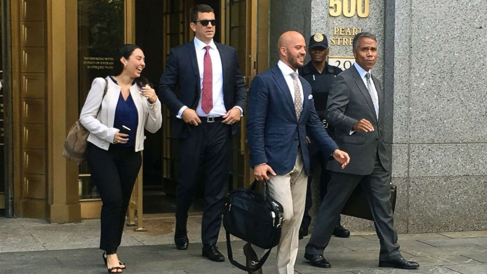 Jonathan Roper, second from left, a former Insys Therapeutics Inc district sales manager, and Fernando Serrano, center, a former sales representative at the company walk with Serrano's lawyer, Jude Cardenas, right, out of federal court after they pleaded not guilty to engaged in a scheme to pay doctors kickbacks to prescribe a fentanyl-based drug the company sells, in New York, Aug, 17, 2016.