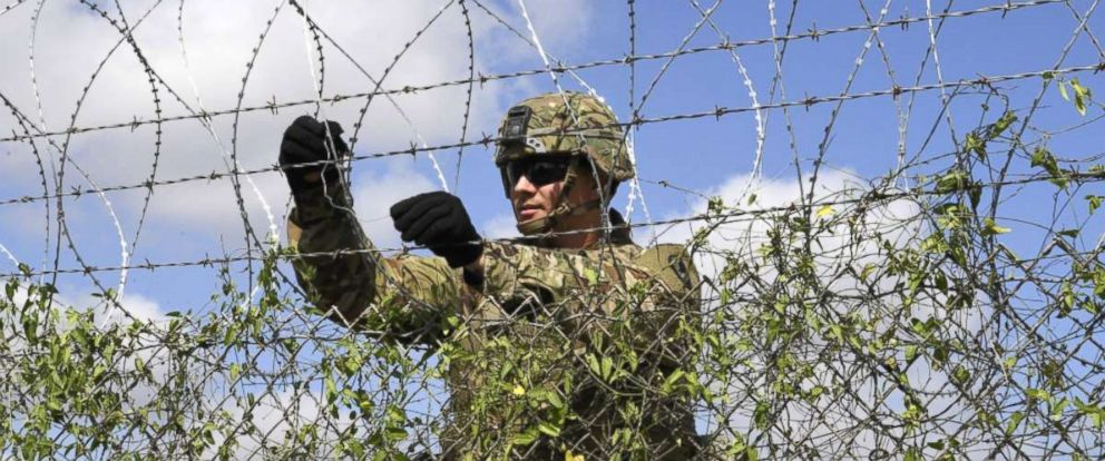 PHOTO: A Soldier installs concertina wire on a fence, Nov. 6, 2018, at Donna Rio Bravo International Bridge, Texas.