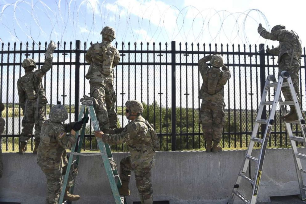 PHOTO: Soldiers from various Engineering Units install concertina wire Nov. 5, 2018, on the Anzalduas International Bridge, Texas.