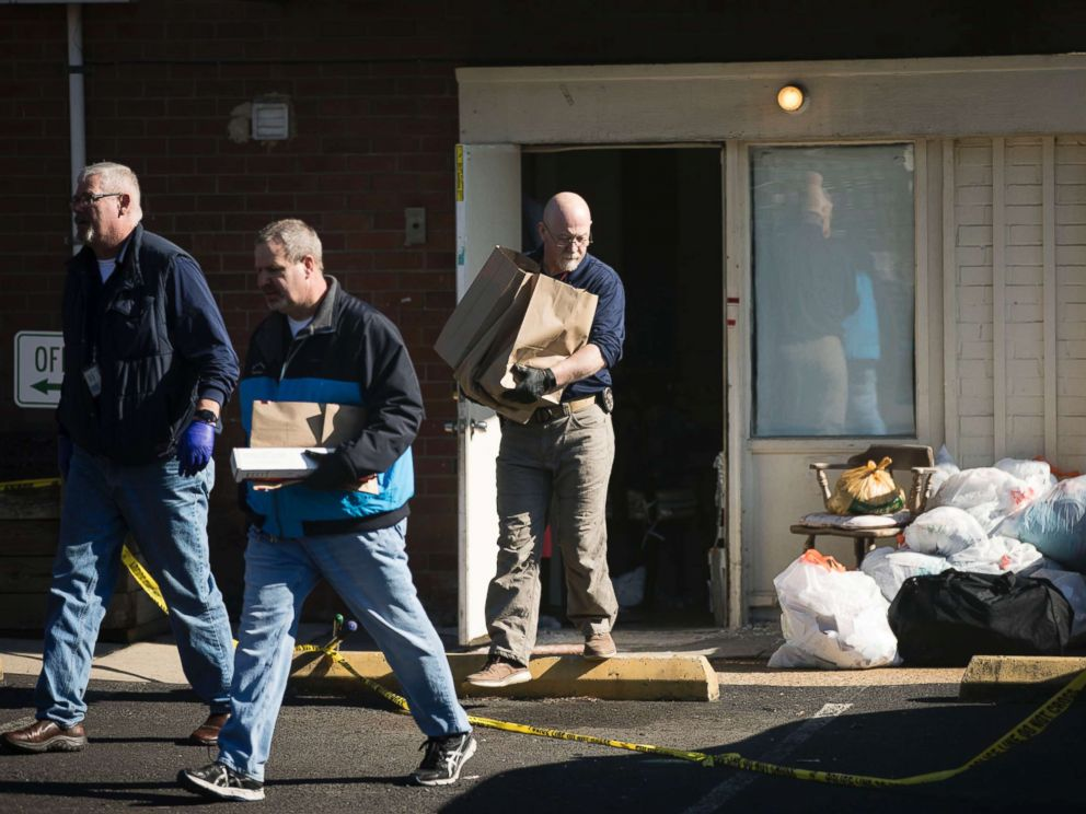 PHOTO: Investigators carry out items from the Robert Morris Apartments in Morrisville, Pa., Feb. 26, 2019.