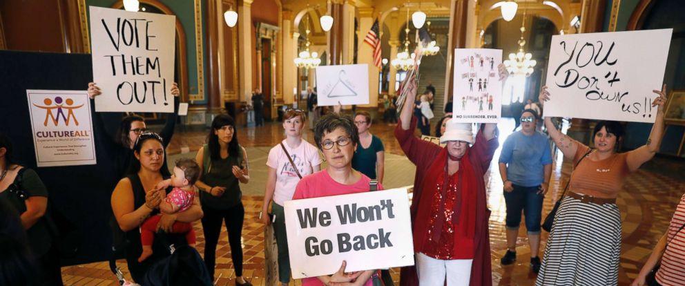 PHOTO: Protesters rally outside Iowa Gov. Kim Reynolds formal office, May 4, 2018, at the Statehouse in Des Moines, Iowa, calling for her to veto a six-week abortion ban bill that would give the state the strictest abortion restrictions in the nation.