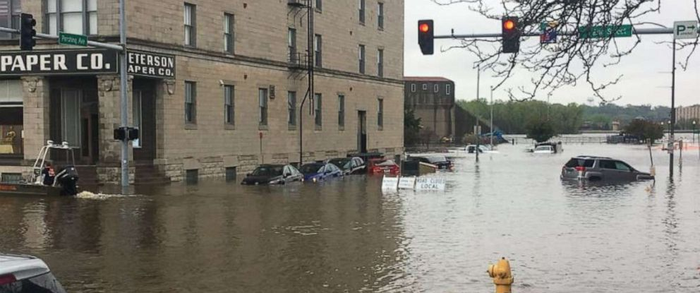 PHOTO: Rain was heavy enough to breach a levee and flood downtown Davenport, Iowa, on Tuesday, April 30, 2019.