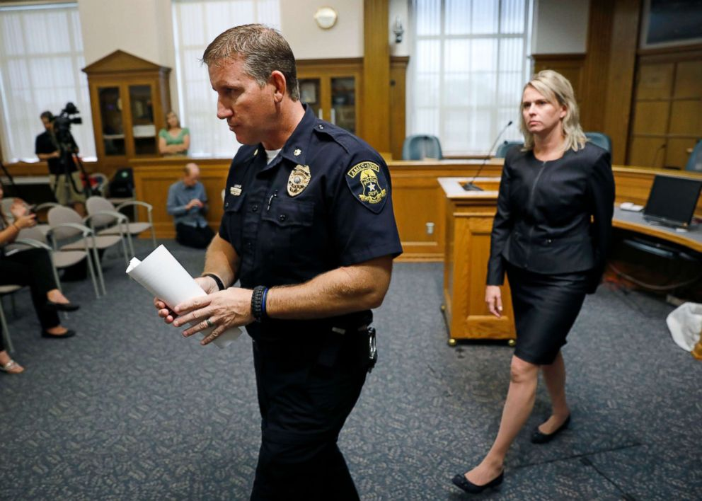 Ames Police Commander Geoff Huff and Story County Attorney Jessica A. Reynolds, right, leave a news conference after speaking about the death of Iowa State University student Celia Barquin Arozamena, Sept. 18, 2018, in Ames, Iowa.
