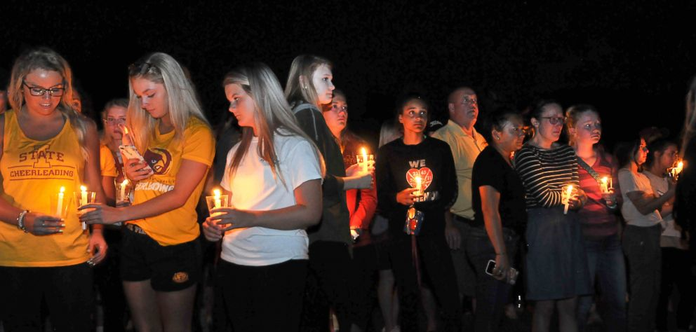 PHOTO: Friends, teammates, students and faculty attend a vigil for former Iowa State golf champion Celia Barquin Arozamena of Spain on the Iowa State campus in Ames, Iowa, Sept. 19, 2018.
