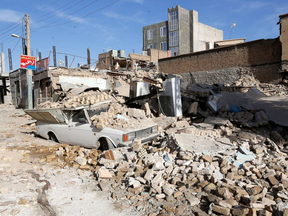 PHOTO: A car trapped under wreckage after an earthquake in the city of Pole-Zahab, in Kermanshah Province, Iran, Nov. 13, 2017.