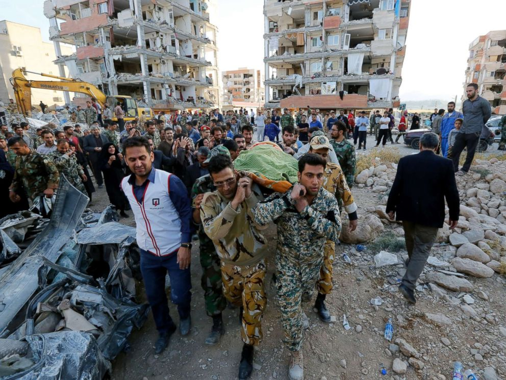 PHOTO: Iranian soldiers carry the body of an earthquake victim near the wreckage of a collapsed building in the city of Pole-Zahab, in Kermanshah Province, Iran, Nov. 13, 2017.