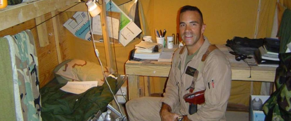 PHOTO: John in Iraq in 2004. He flew 75 combat missions in a Cobra there. He died by suicide three months after he returned home.
