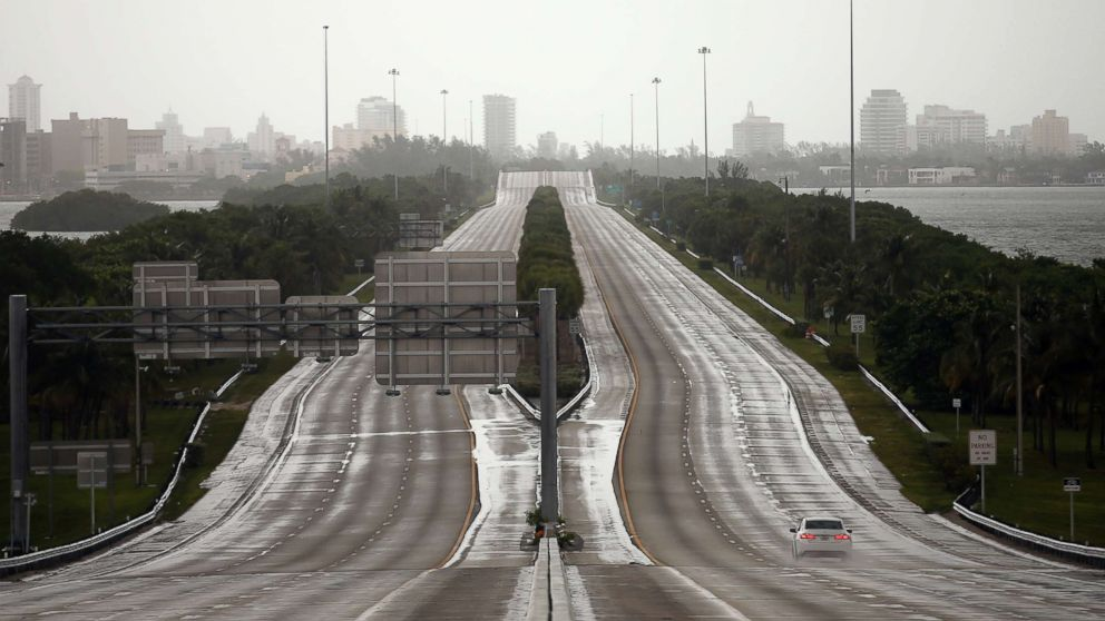 A car drives along an empty highway in Miami before the arrival of Hurricane Irma to south Florida, Sept. 9, 2017. REUTERS/Carlos Barria