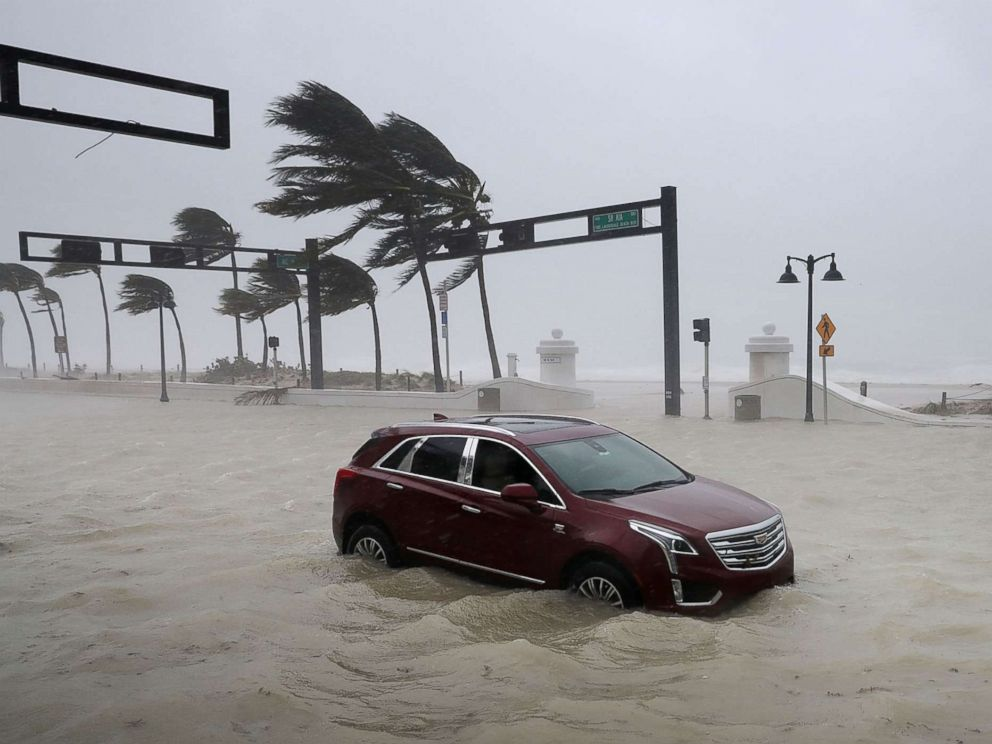 PHOTO: A car sits abandoned in storm surge waters along North Fort Lauderdale Beach Boulevard as Hurricane Irma hits the southern part of the state Sept. 10, 2017 in Fort Lauderdale, Fla.