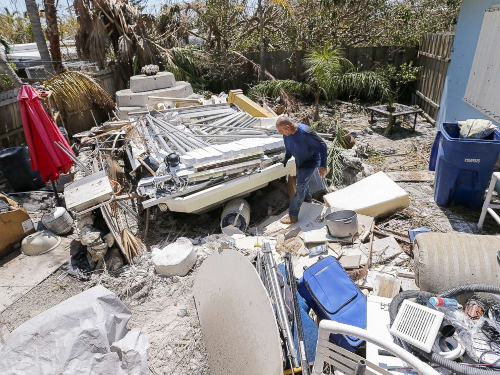 PHOTO: Reynaldo Martinez surveys the debris deposited in his backyard after Hurricane Irma struck the Florida Keys in Marathon, Fla., Sept. 12, 2017.