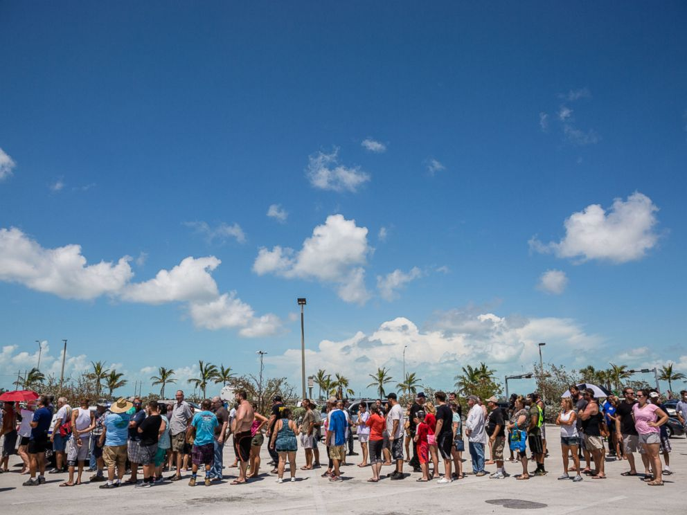 PHOTO: Residents line up for food and water relief supplies in a shopping center parking lot in Key West, Fla., Sept. 13, 2017.