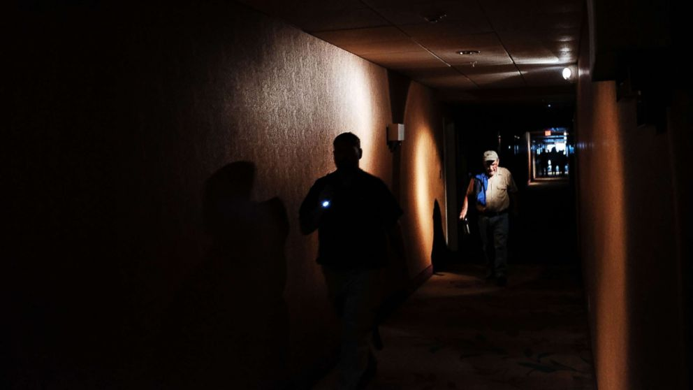 Hotel guests walk through dark hallways after the electricity was lost as Hurricane Irma arrives into southwest Florida, Sept. 10, 2017 in Fort Myers, Florida.