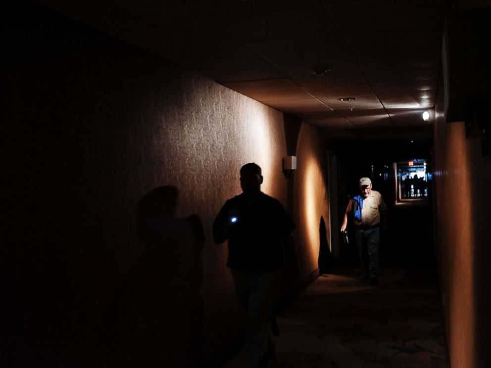 PHOTO: Hotel guests walk through dark hallways after the electricity was lost as Hurricane Irma arrives into southwest Florida, Sept. 10, 2017 in Fort Myers, Florida.