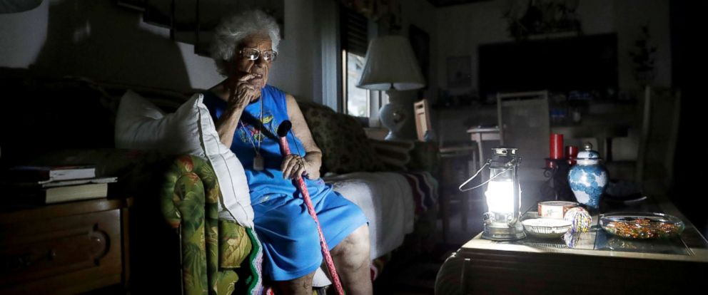 PHOTO: Mary Della Ratta, 94, sits by a battery powered lantern in her home three days after Hurricane Irma knocked out power in Naples, Fla., Sept. 13, 2017.