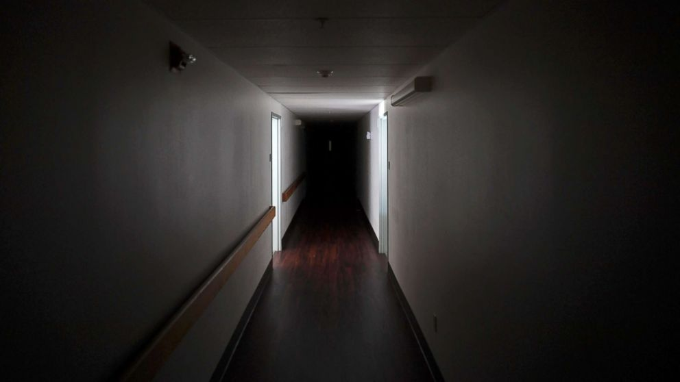 A darkened hallway is pictured at Cypress Run assisted living facility, after Hurricane Irma caused the power outage in the building in Immokalee, Fla. Sept. 12, 2017.
