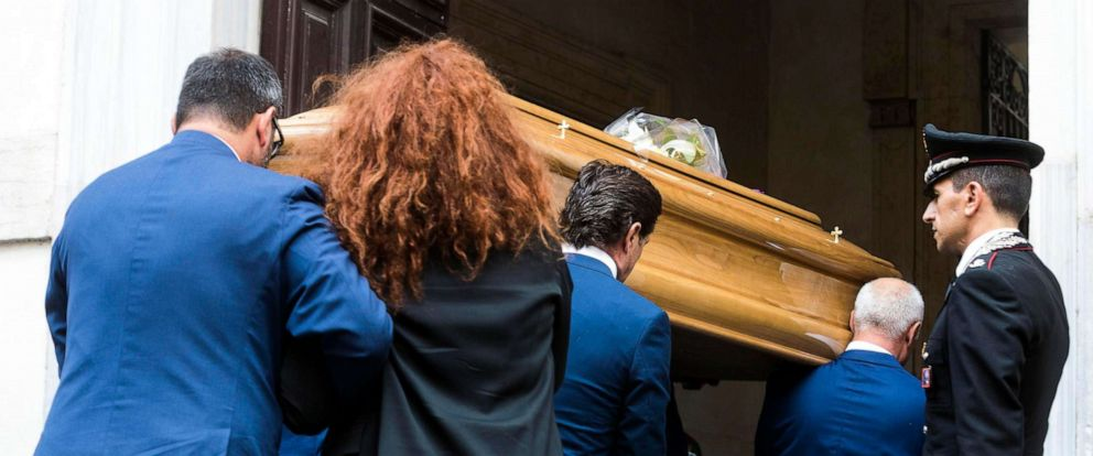 PHOTO: Carabinieri officer Mario Cerciello Regas wife, Rosa Maria, follows the coffin of her husband as it arrives to be laid in state, in Rome, July 28, 2019.