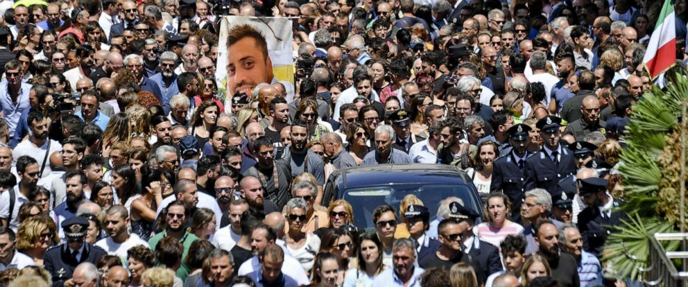 PHOTO: A photograph of Carabinieri officer Mario Cerciello Rega is carried during his funeral in his hometown of Somma Vesuviana in southern Italy, July 29, 2019.