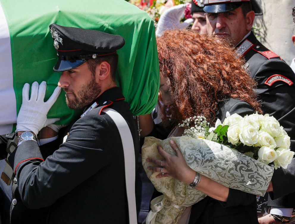 PHOTO: Carabinieri officer Mario Cerciello Regas wife, Rosa Maria, right, follows the coffin containing the body of her husband during his funeral in his hometown of Somma Vesuviana, near Naples, Italy, July 29, 2019.