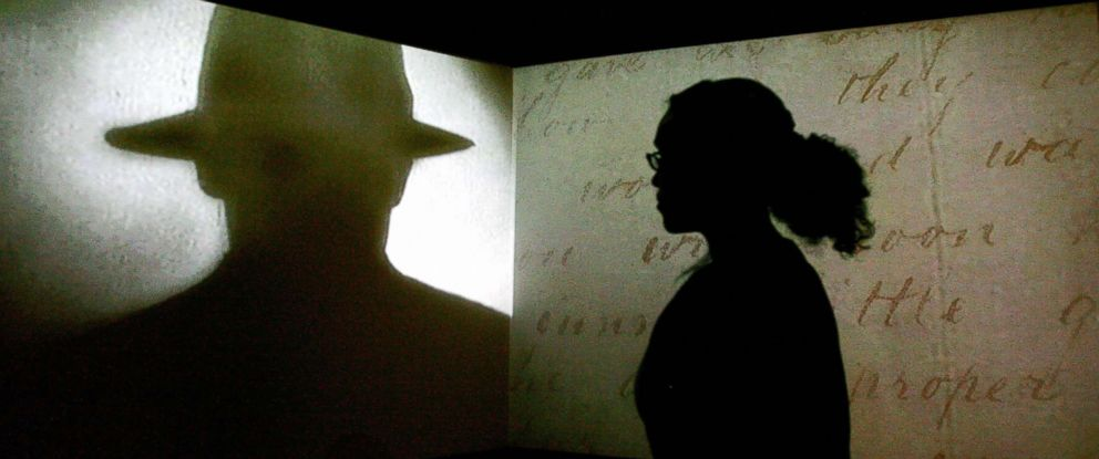 """PHOTO: A visitor watches a black and white projection during a press preview of the """"Jack the Ripper and the East End"""" exhibition at Museum in Docklands, in London, May 14, 2008."""