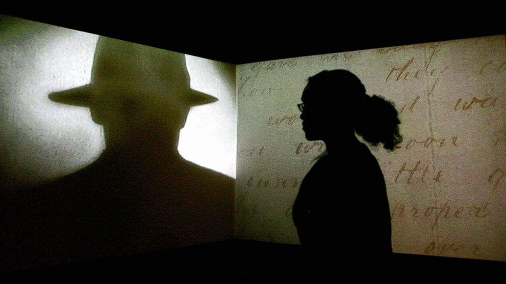 "A visitor watches a black and white projection during a press preview of the ""Jack the Ripper and the East End"" exhibition at Museum in Docklands, in London, May 14, 2008."