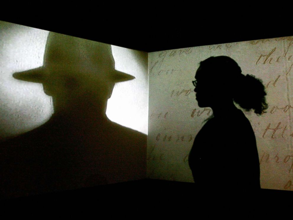 PHOTO: A visitor watches a black and white projection during a press preview of the Jack the Ripper and the East End exhibition at Museum in Docklands, in London, May 14, 2008.