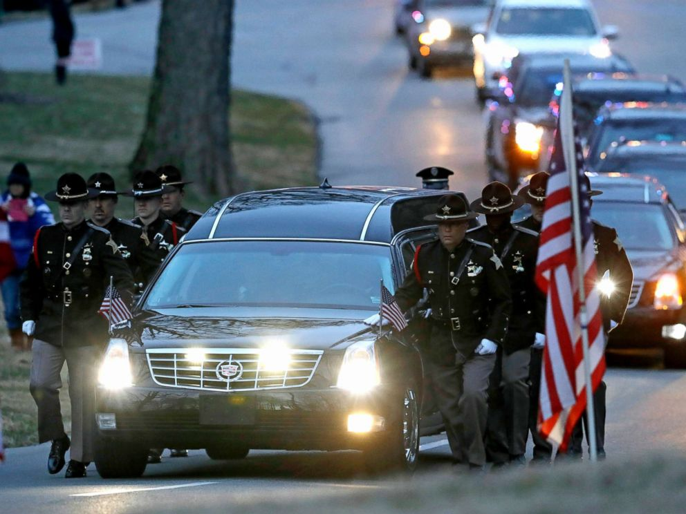 PHOTO: The honor guard walks along the hearse carrying the casket of Boone County Sheriffs Deputy Jacob Pickett, March 9, 2018, in Indianapolis.