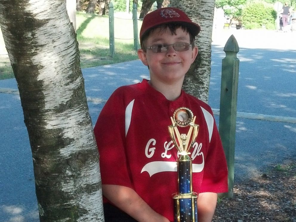 This photo provided by Richard Taras shows Jacobe Taras with a baseball championship trophy in 2014, a year before he committed suicide over school bullying in Moreau, N.Y.