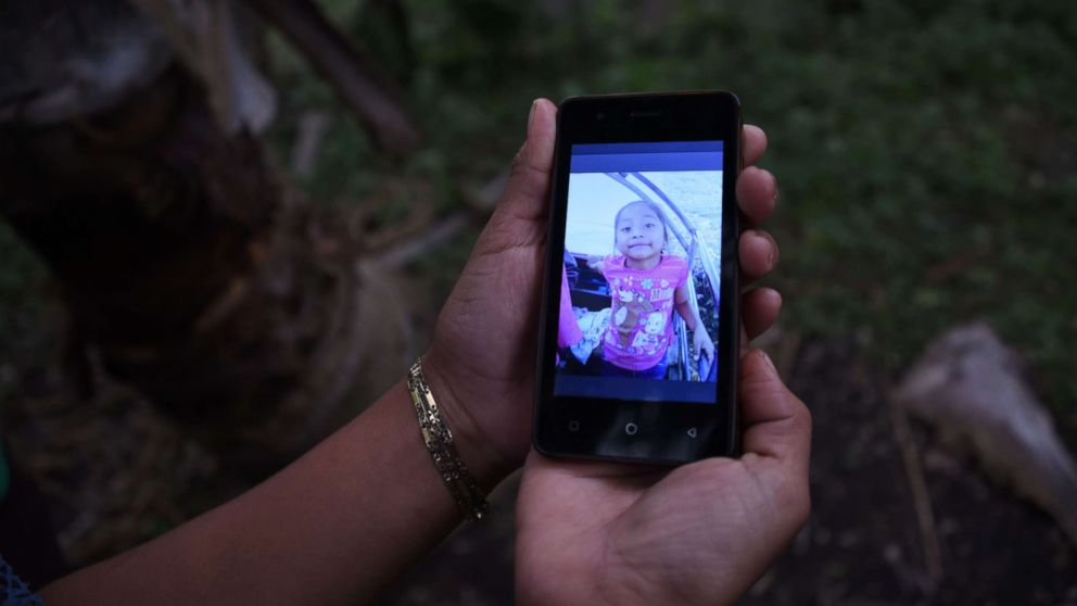 A relative shows a picture of 7-year old Jakelin Caal Maquin, who died in a Texas hospital two days after being taken into custody by border patrol agents, north of Guatemala city, Dec. 15, 2018.
