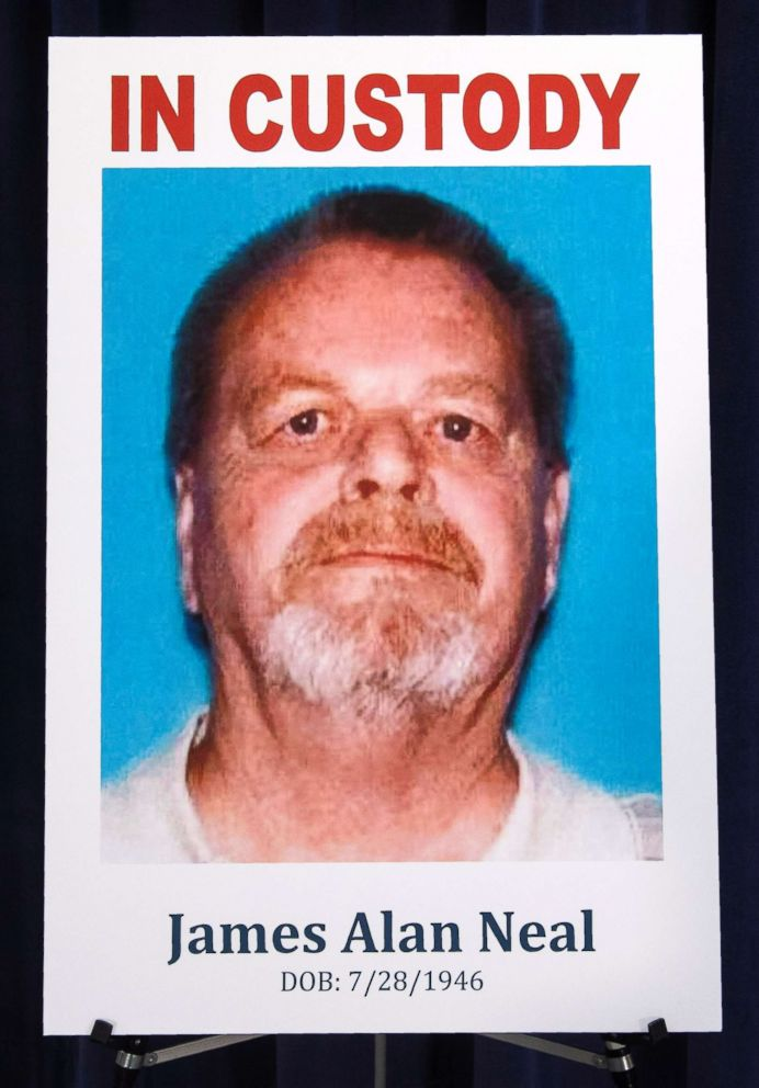 This photo shows a poster of James Neal during a news conference at the Orange County District Attorney's office in Santa Ana, Calif., Feb. 20, 2019.