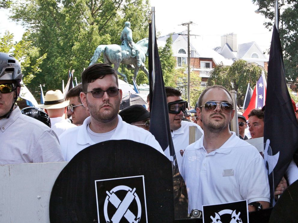 PHOTO: In this Aug. 12, 2017 photo, James Alex Fields Jr., second from left, holds a black shield in Charlottesville, Va., where a white supremacist rally took place.