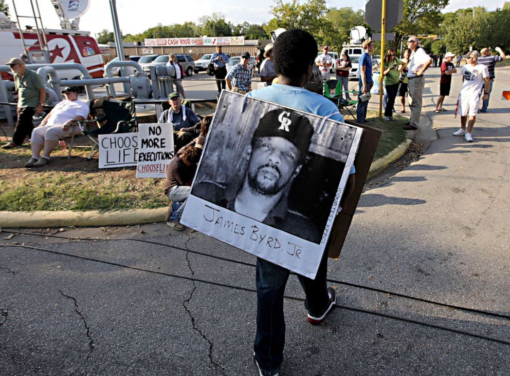 PHOTO:In this file photo, Ricky Jason wears a photograph of James Byrd Jr. outside the Texas Department of Criminal Justice Huntsville Unit on the day of the execution of Lawrence Russell Brewer, Sept. 21, 2011, in Huntsville, Texas.