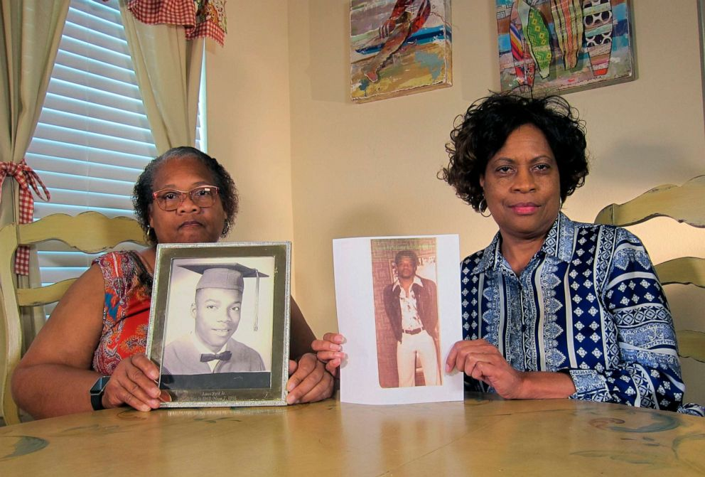 PHOTO: In this April 10, 2019, photo Mylinda Byrd Washington, 66, left, and Louvon Byrd Harris, 61, hold up photographs of their brother James Byrd Jr. in Houston.