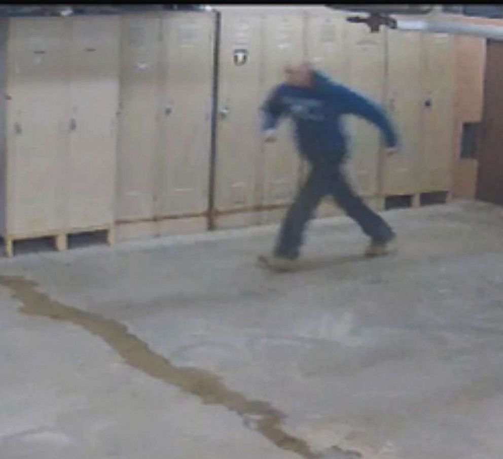 PHOTO: Shoplifting suspect James Hlavsa runs out a police department garage after slipping out of his handcuffs. He is still on the run.