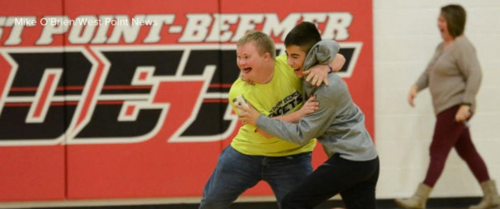 PHOTO: James Myer-Gerd, a senior with Down syndrome, hit a no-look, backward shot from half-court during halftime.