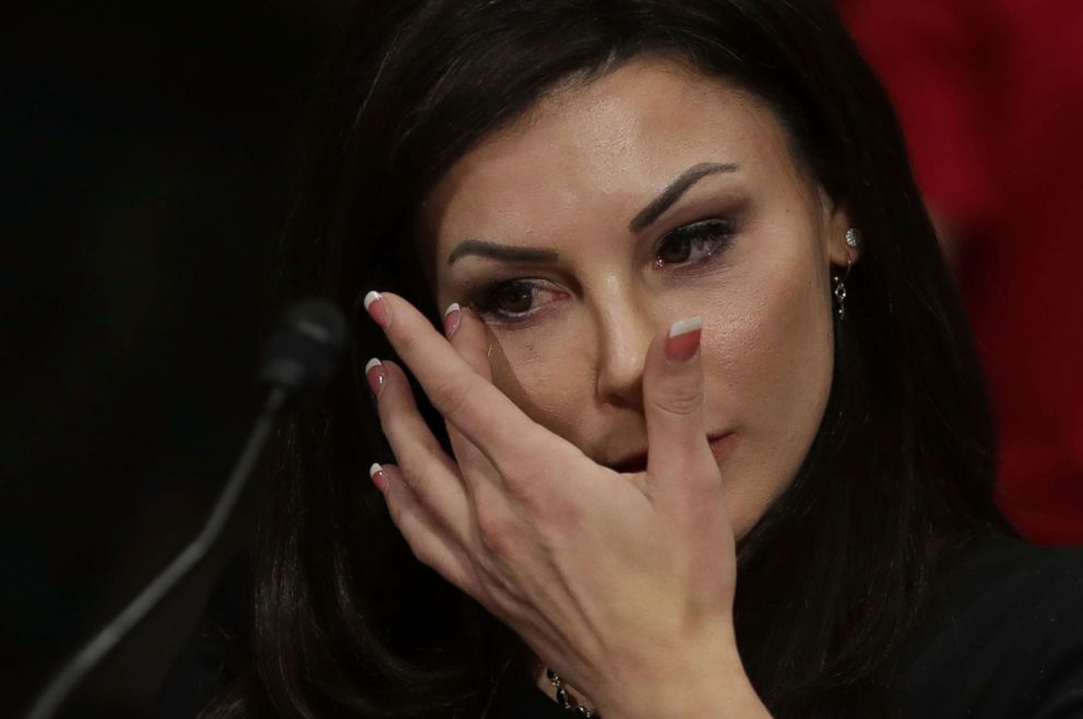 PHOTO: Jamie Dantzscher, former gymnast and 2000 Olympic Bronze Medalist, wipes away tears while testifying before the Senate Judiciary Committee about her sexual abuse at the hands of a team doctor during a hearing, March 28, 2017.