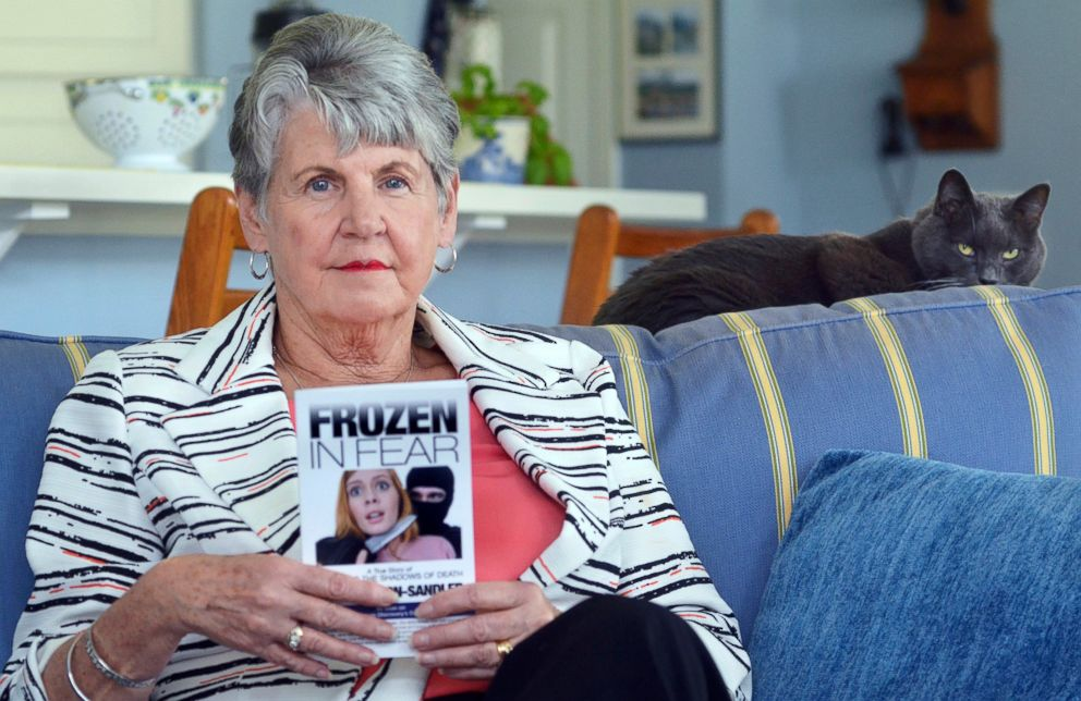 PHOTO: Rape survivor Jane Carson-Sandler, of Sun City Hilton Head, S.C. poses for a photo holding a copy of her book about the experience called, Frozen in Fear.