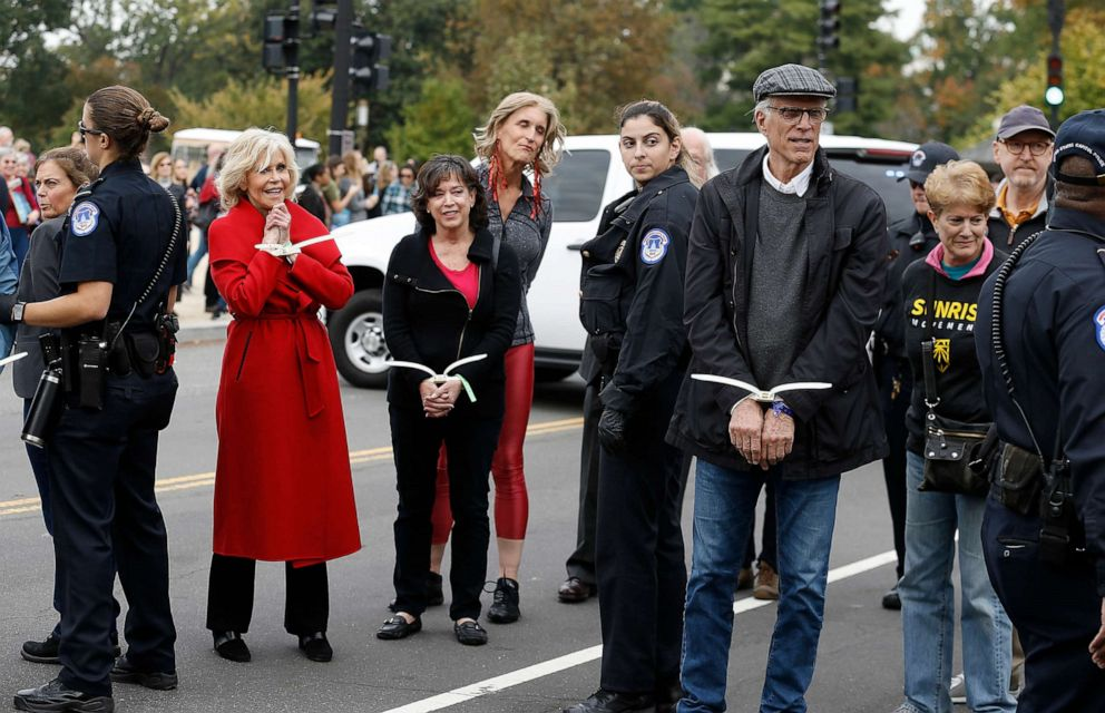 PHOTO: Actors Jane Fonda and Ted Danson are arrested during the Fire Drill Friday Climate Change Protest on Oct.25, 2019, in Washington, D.C.