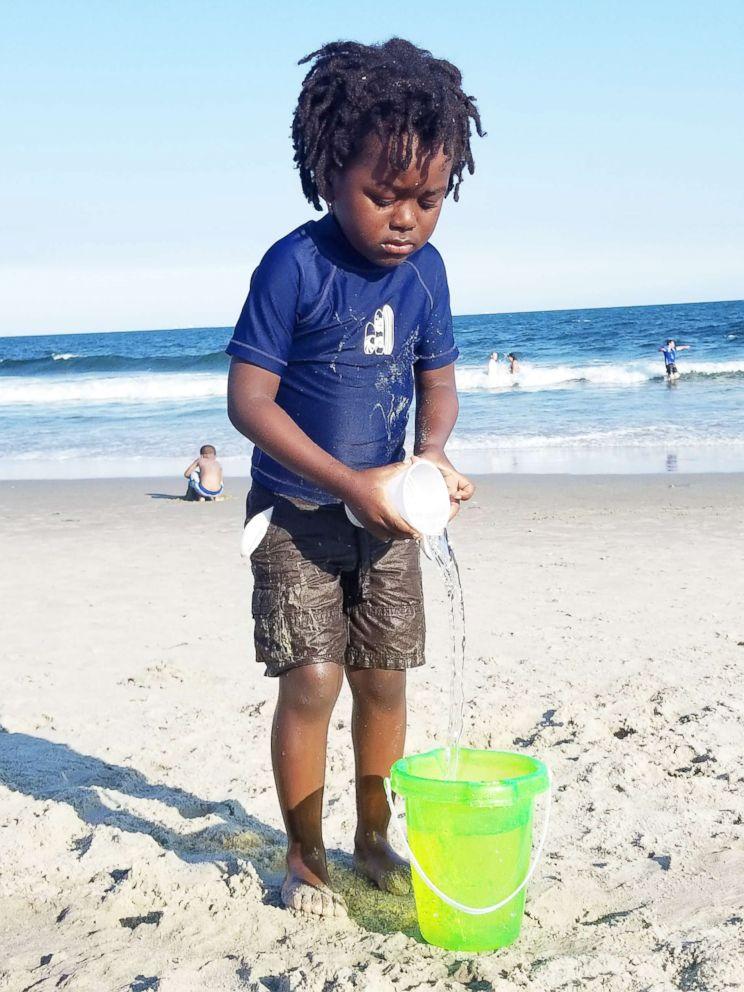 PHOTO: Jayden Okungu enjoys a day out at the beach.