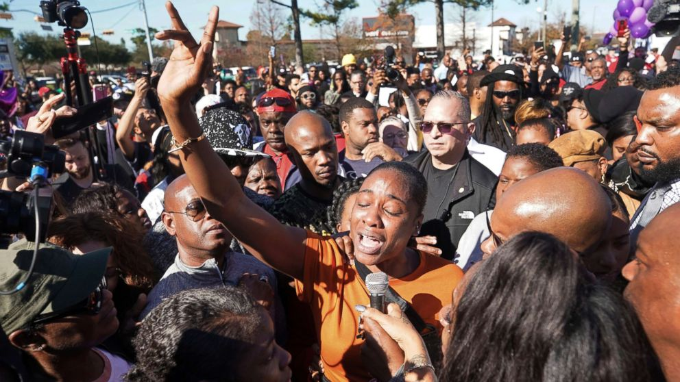 LaPorsha Washington, center, the mother of seven-year-old daughter Jazmine Barnes, who was killed on Sunday, speaks to the crowd during a community rally in Houston, Jan. 5, 2019.