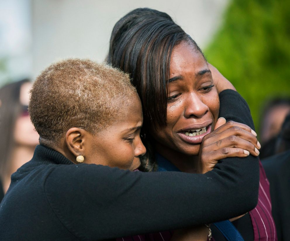 PHOTO: LaPorsha Washington, right, is embraced as the casket of her daughter Jazmine Barnes is placed inside a funeral hearse after a memorial service, Jan. 8, 2019, in Houston.