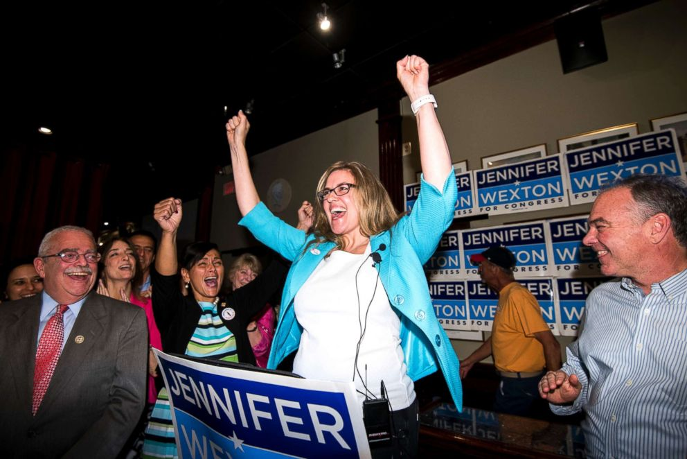 PHOTO: Jennifer Wexton, center, speaks flanked by Rep. Gerry Connolly, left, and Sen. Tim Kaine, at her primary election night party in Sterling, Va., on June 12, 2018.