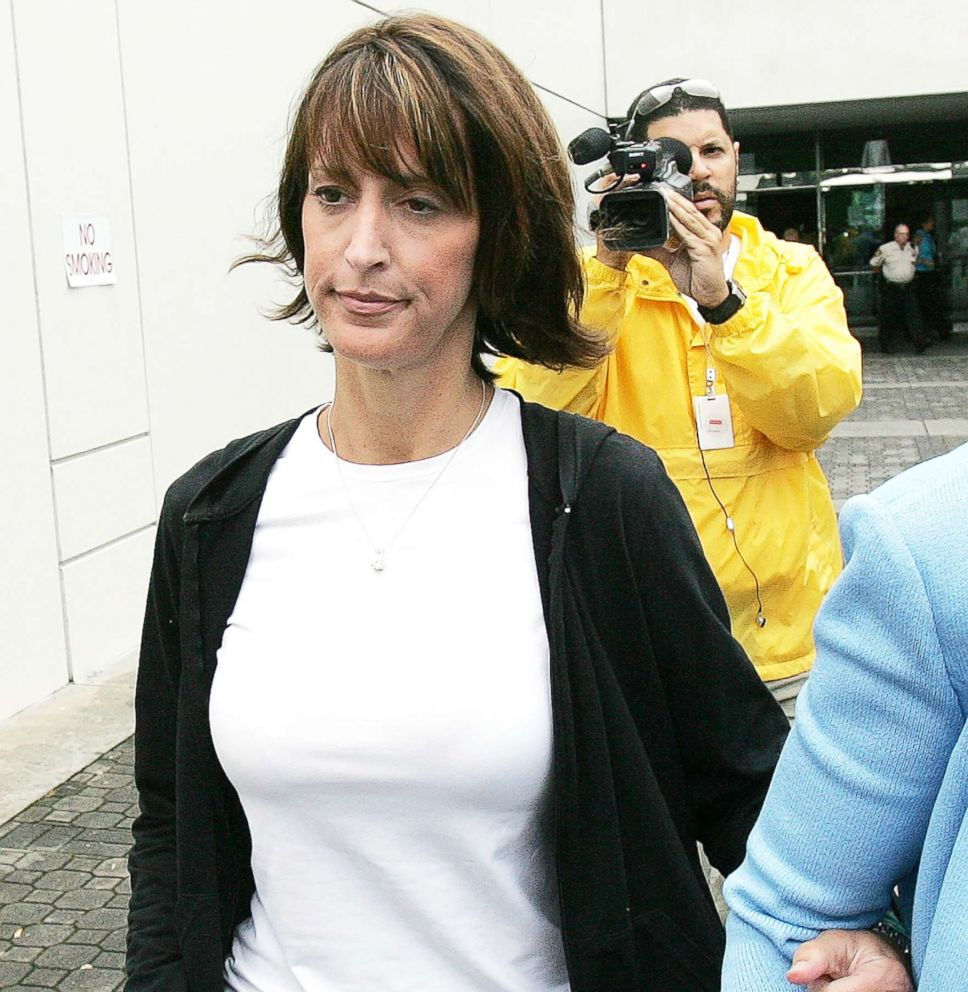 """Jennifer Wilbanks, whose disappearance days before her 2005 wedding earned her the moniker """"Runaway Bride,""""  leaves the Gwinnett County courthouse in Lawrenceville, Ga., June 2, 2005 file photo."""