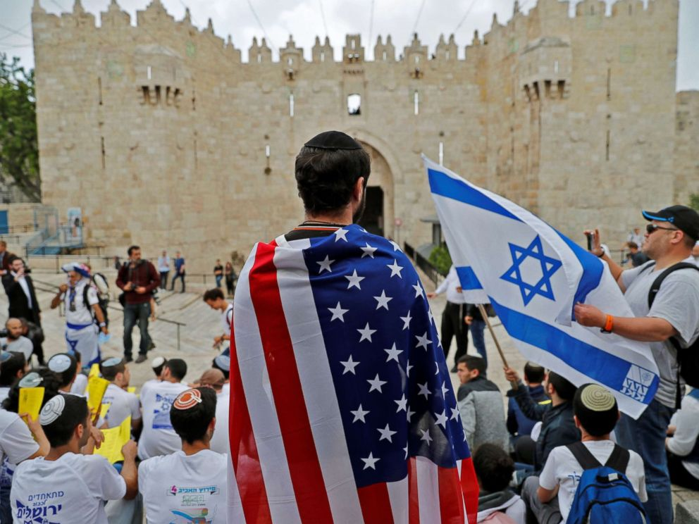 PHOTO: An Israeli man wears the US national flag at Damascus gate in Jerusalem on May 13, 2018, as Israeli nationalist settlers celebrate the Jerusalem Day in the Old City.
