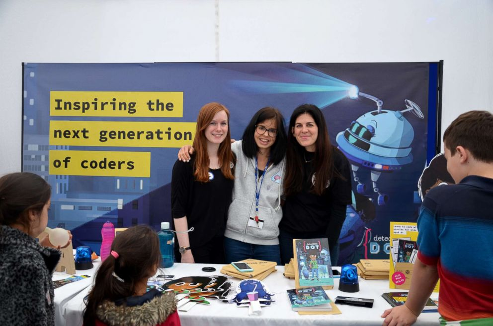 PHOTO: Jess Wade, center, attends a coding event with fellow peers.