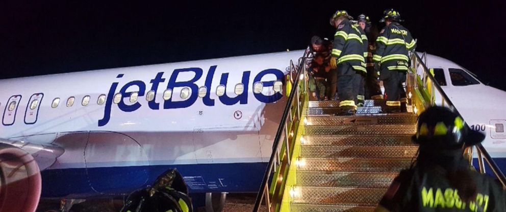 PHOTO: Firefighters help passengers off the plane after it skidded off the taxiway at Bostons Logan Airport, Dec. 26, 2017.