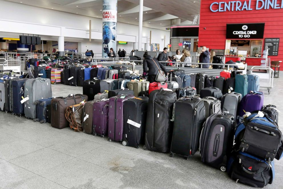 PHOTO: A woman looks through unclaimed baggage at New Yorks John F. Kennedy Airport Terminal 4, Jan. 8, 2018.