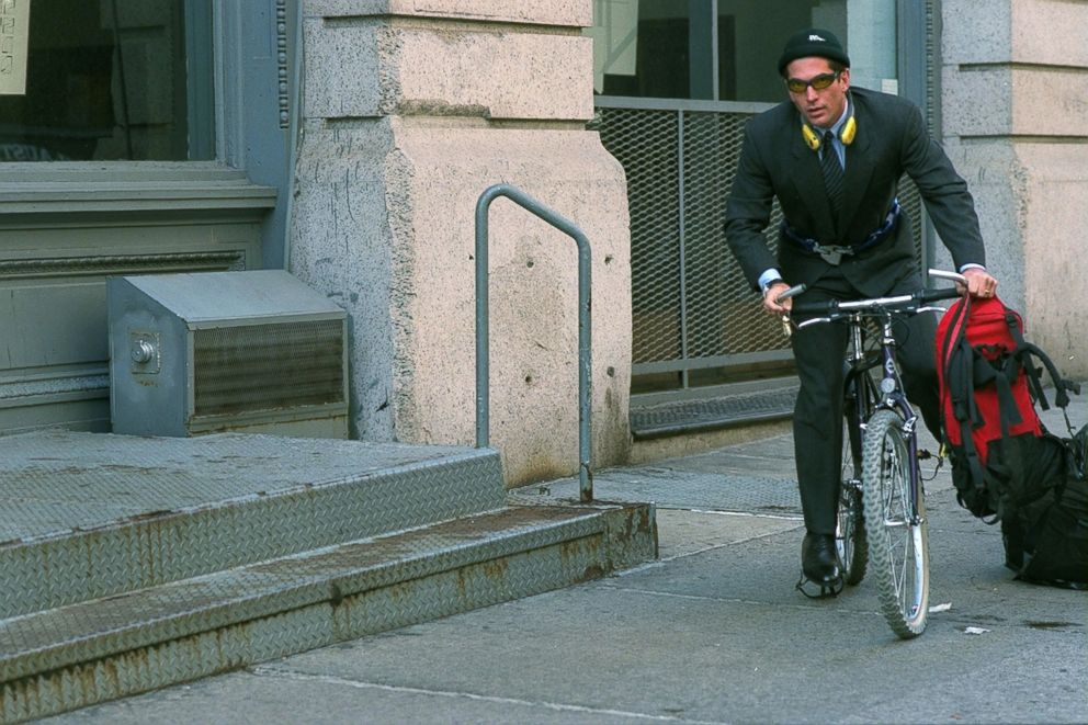 John F. Kennedy Jr. boards his bicycle outside his Tribecca home in New York City.